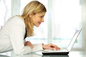 woman looking at laptop